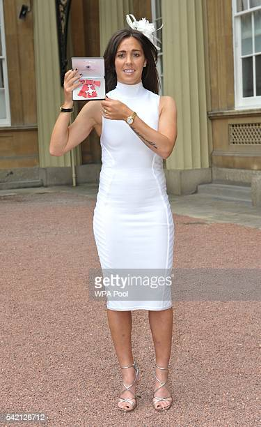 England Women footballer Fara Williams poses after she received her Member of Order of the British Empire medal from the Princess Royal during an...