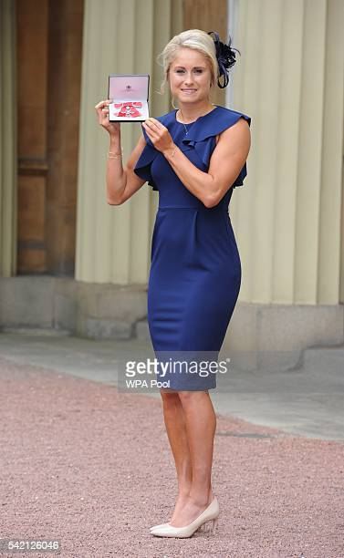 England Women footballer Stephanie Houghton poses after she received her Member of Order of the British Empire medal from the Princess Royal during...