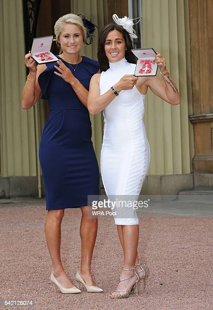 England Women footballers Stephanie Houghton and Fara Williams pose after she received her Member of Order of the British Empire medal from the...