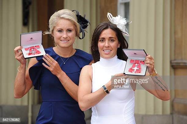 England Women footballers Stephanie Houghton and Fara Williams pose after they received their Member of Order of the British Empire medals from the...