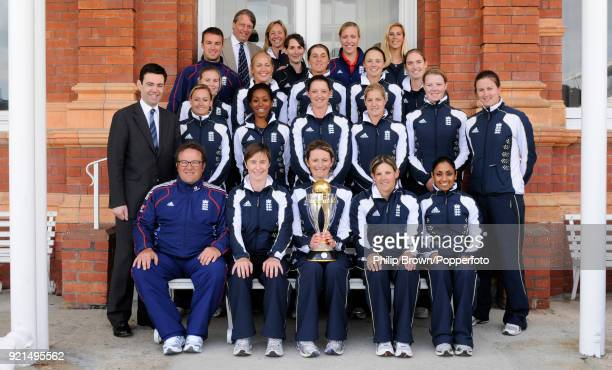 England Women's captain Charlotte Edwards holds the World Cup trophy with the rest of the England team and Secretary of State for Culture Media and...