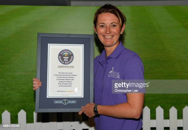 England Women's Captain Charlotte Edwards poses for the camera with her Guinness World Record Certificate for the Most Runs Scored in Female One Day...