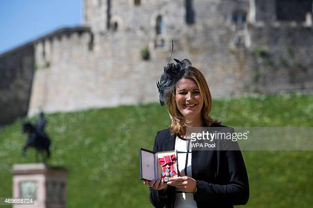 England women's cricket captain Charlotte Edwards holding her Commander of the British Empire after it was awarded to her by the Queen at an...