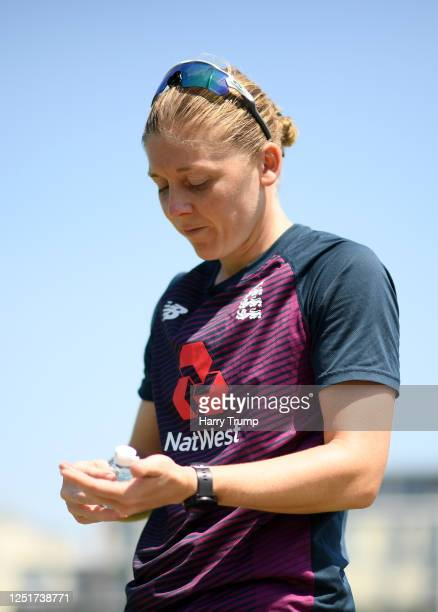 England Women's Cricket Captain Heather Knight looks on whilst using hand sanitizer as she takes part in an individual training session at the County...