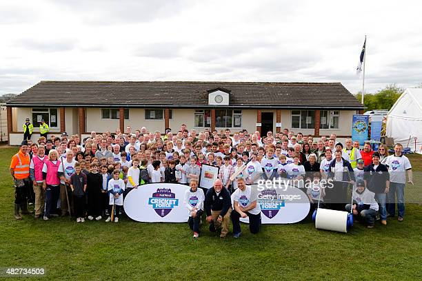 England women's cricket player Danielle Wyatt and ex England cricket players Matthew Hoggard and Mike Gatting pose for a photograph with local school...