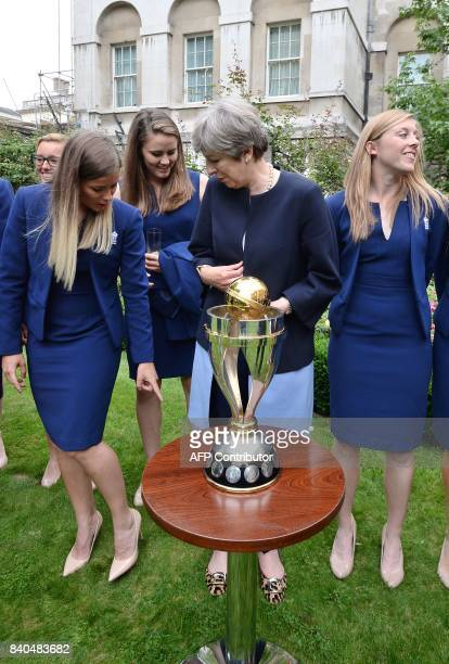 England women's cricket team captain Heather Knight reacts as Britain's Prime Minister Theresa May talks to to her teammates as they stand by the ICC...
