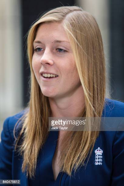 England women's cricket team captain Heather Knight speaks to media before attending a reception with teammates at 10 Downing Street on August 29...