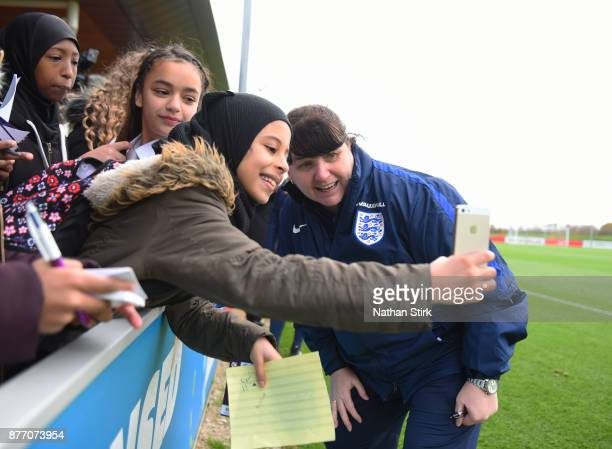 England Women's interim head coach Mo Marley poses for a photograph with fans during a training session at St Georges Park on November 21 2017 in...