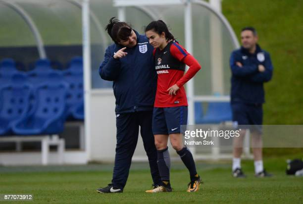 England Women's interim head coach Mo Marley talks to Karen Carney during a training session at St Georges Park on November 21 2017 in...