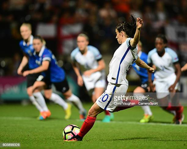 England women's Karen Carney scores her sides fifth goal from the penalty spot during the UEFA Womens European Championship Qualifying Group 7 match...