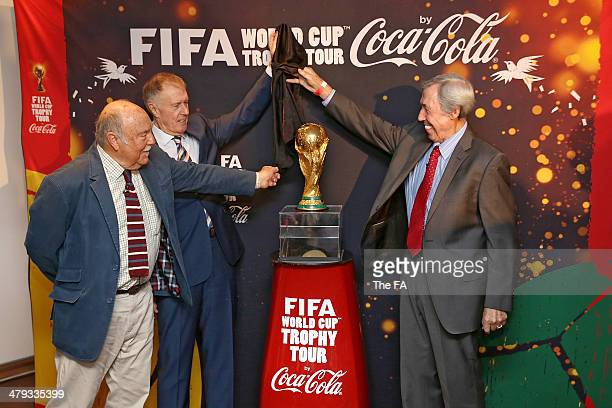England World Cup winners Jimmy Greaves, Sir Geoff Hurst and Gordon Banks unveil the FIFA World Cup Trophy at Wembley Stadium as part of celebrations...