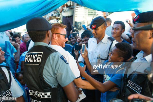 Englandborn coach Ben Ryan arrives with Fiji's Olympic goldmedalwinning men's sevens rugby team on their return from Rio in Nadi on August 21 2016...