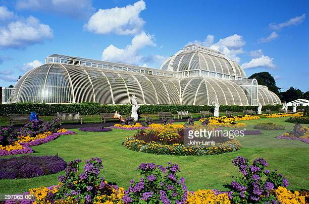 England,London,Kew Gardens,Palm House and flowerbeds