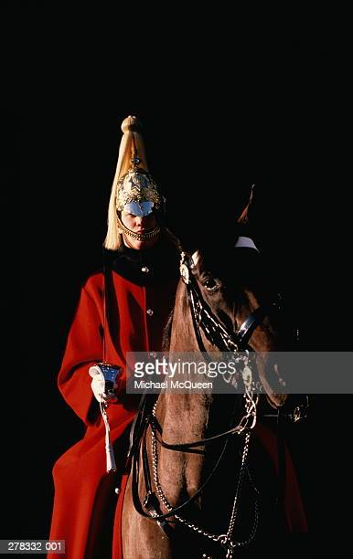 england,london,whitehall,horse guard,black background - british military stock photos and pictures