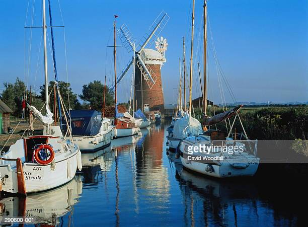 England,Norfolk Broads,Horsey,boats on canal,windmill in background