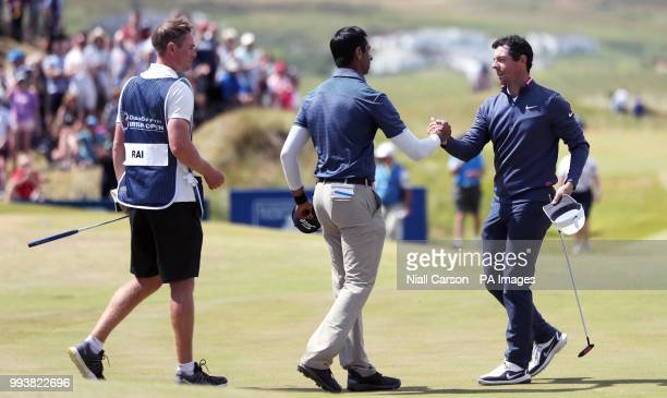 England's Aaron Rai and Northern Ireland's Rory McIlroy shake hands at the end of their round on the 18th during day four of the Dubai Duty Free...