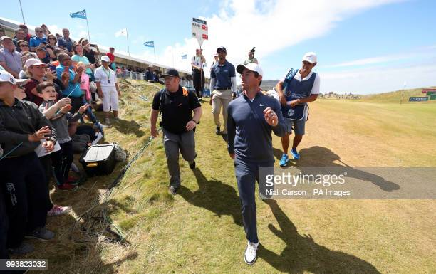 England's Aaron Rai and Northern Ireland's Rory McIlroy walk off the 18th during day four of the Dubai Duty Free Irish Open at Ballyliffin Golf Club