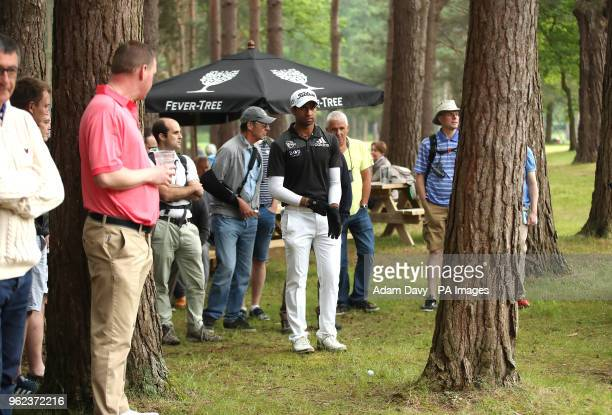 England's Aaron Rai line up a shot behind a tree on the 13th hole during day two of the 2018 BMW PGA Championship at Wentworth Golf Club Surrey