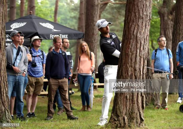 England's Aaron Rai plays out of the rough behind a tree on the 13th hole during day two of the 2018 BMW PGA Championship at Wentworth Golf Club...