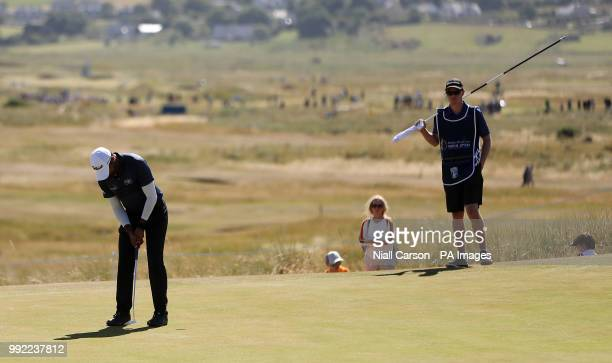 England's Aaron Rai putts on the fourteenth green during day one of the Dubai Duty Free Irish Open at Ballyliffin Golf Club