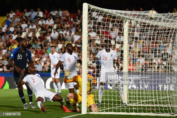 England's Aaron WanBissaka scores an own goal under pressure from France's Marcus Thuram during the Group C match of the U21 European Football...