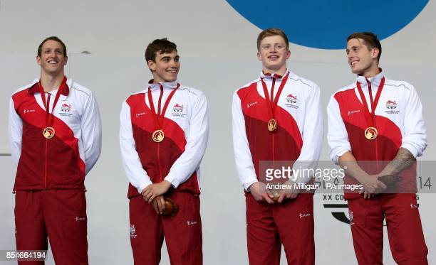 England's Adam Brown Adam Barrett Adam Peaty and Chris WalkerHebborn collect their gold medals for the Men's 4 x 100m Medley Relay Final at Tollcross...