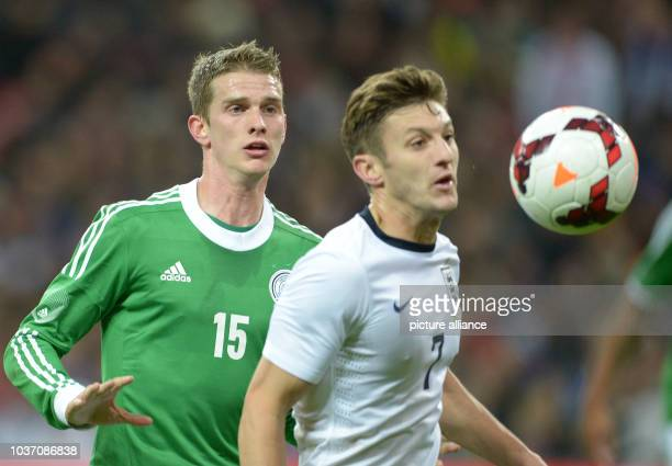 England's Adam Lallana and Germany's Lars Bender fight for the ball during the friendly soccer match between England and Germany at Wembley Stadium...