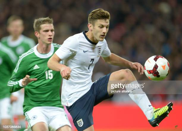 England's Adam Lallana and Germany's Lars Bender vie for the ball during the friendly soccer match between England and Germany at Wembley Stadium in...