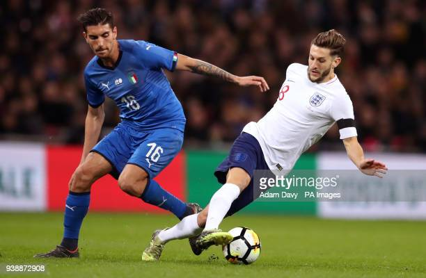 England's Adam Lallana and Italy's Lorenzo Pellegrini battle for the ball during the international friendly match at Wembley Stadium London