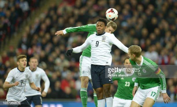 England's Adam Lallana Daniel Sturridge and Germany's Sven Bender and Per Mertesacker vie for the ball during the friendly soccer match between...