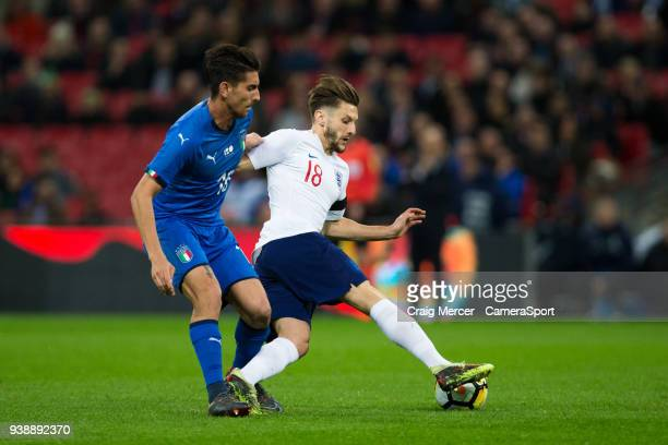 England's Adam Lallana holds off the challenge from Lorenzo Pellegrini of Italy during the International Friendly match between England and Italy at...