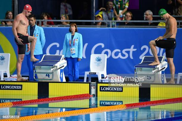 England's Adam Peaty and South Africa's Cameron van der Burgh prepare to compete in the swimming men's 50m breaststroke final during the 2018 Gold...