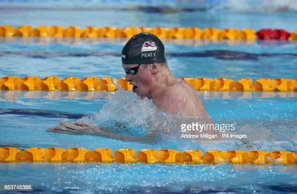 England's Adam Peaty competes in the Men's 100m Breaststroke Heat 5 at Tollcross International Swimming Centre during the 2014 Commonwealth Games in...