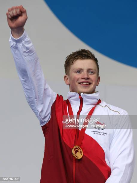 England's Adam Peaty with his gold medal after winning the Mens 100m Breastroke at Tollcross Swimming Centre during the 2014 Commonwealth Games in...