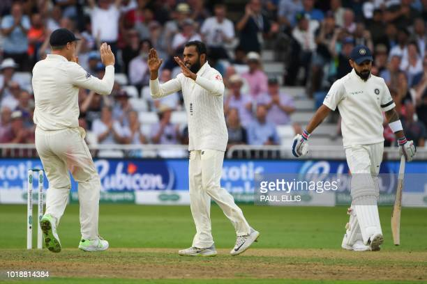 England's Adil Rashid celebrates taking the wicket of India's captain Virat Kohli for 97 runs during the first day of the third Test cricket match...