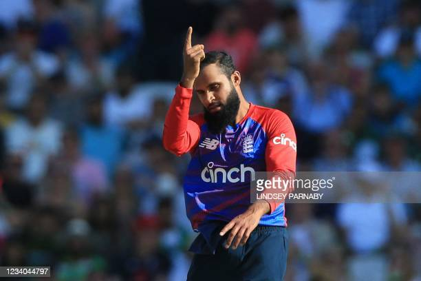 England's Adil Rashid celebrates taking the wicket of Pakistan's Sohaib Maqsood during the second T20 international cricket match between England and...