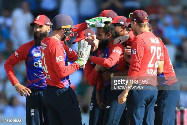 England's Adil Rashid celebrates taking the wicket of Pakistan's Mohammad Rizwan during the second T20 international cricket match between England...