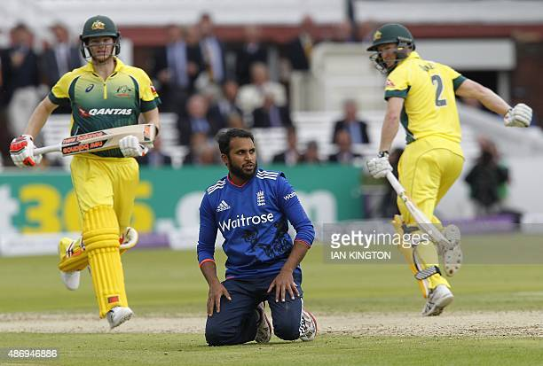 Englands Adil Rashid reacts after bowlig as Australias captain Steven Smith and Australias George Bailey make runs during the second one day...