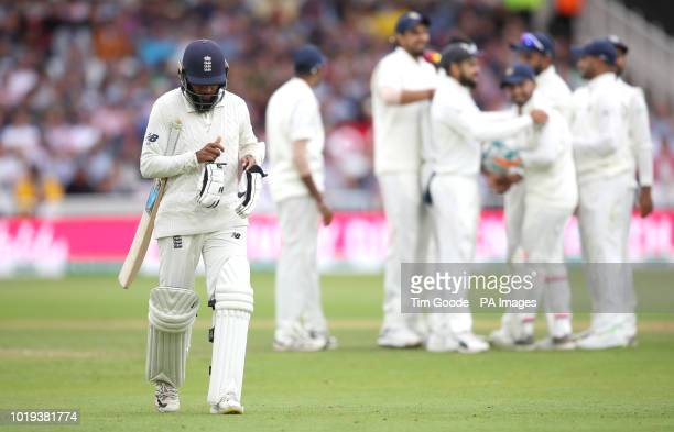 England's Adil Rashid walks off after getting out during day two of the Specsavers Third Test match at Trent Bridge Nottingham