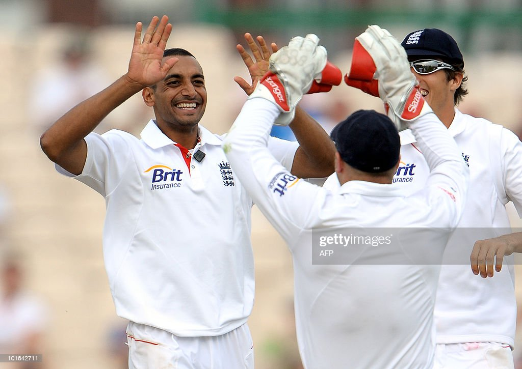 England's Ajmal Shahzad (L) celebrates after taking the wicket of Mohammad Ashraful of Bangladesh (not pictured) during the second day of the second Test match at Old Trafford in Manchester, north-west England on June 5, 2010.