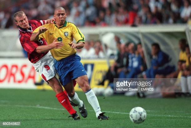 England's Alan Shearer holds onto the shirt of Brazil's Ronaldo causing them both to be booked
