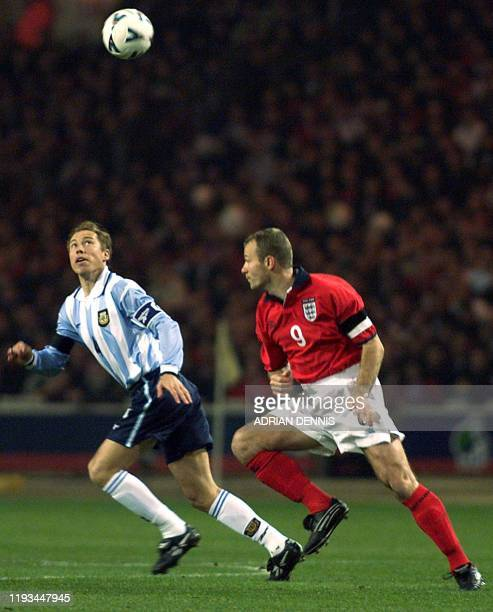 England's Alan Shearer vies with Argentina's Javier Zanetti during first half action of the international friendly match at Wembley Stadium in London...