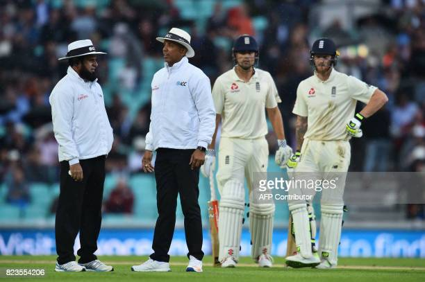 England's Alastair Cook and England's Ben Stokes wait as the umpires discuss the rain on the first day of the third Test match between England and...