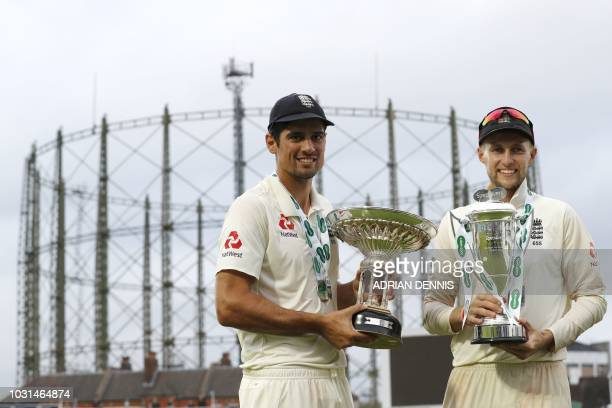England's Alastair Cook and England's captain Joe Root pose with the Pataudi trophy and the series trophy after winning the fifth Test cricket match...