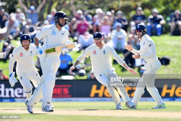 England's Alastair Cook and teammates Ben Stokes and keeper Jonny Bairstow celebrate New Zealand's Ross Taylor being caught during day five of the...