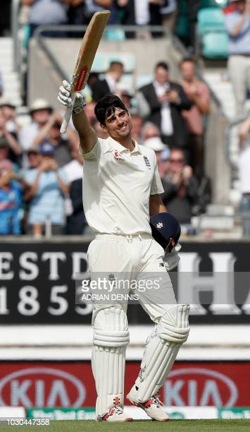 England's Alastair Cook celebrates his century during play on the fourth day of the fifth Test cricket match between England and India at The Oval in...