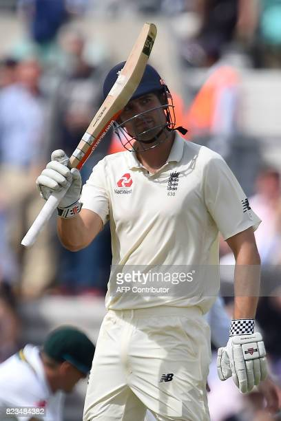 England's Alastair Cook celebrates his half century on the first day of the third Test match between England and South Africa at The Oval cricket...