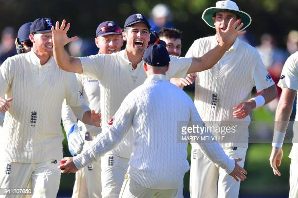 England's Alastair Cook celebrates New Zealand's Colin de Grandhomme being caught with teammate Jack Leach during day five of the second cricket Test...