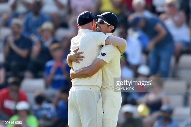 England's Alastair Cook embraces England's Ben Stokes after catching out India's Rishabh Pant during play on the fourth day of the fourth Test...