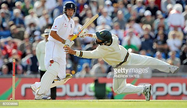England's Alastair Cook hits the ball past Hashim Amla of South Africa during the third day of the second test cricket match on July 20 2008 at...